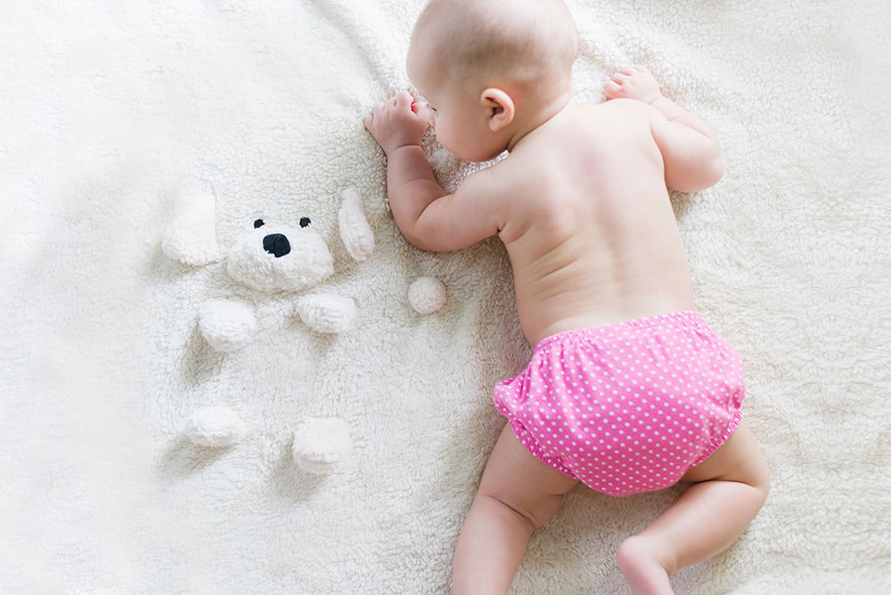 Color psychology in marketing – baby wearing pink nappy.